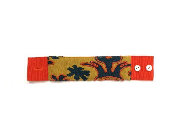 Bracciale 'Palma' in tessuto lampasso con ricamo in cotone perlè arancio e finitura in gros grain arancio